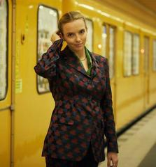 Killing Eve Dries Van Noten patterned suit and gold chain